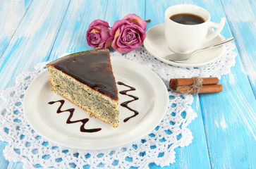 Delicious poppy seed cake with cup of coffee on table close-up