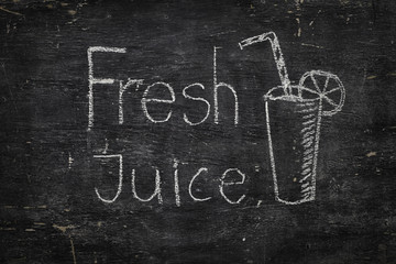 Chalk on black board: Fresh Juice