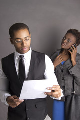 African American Business Couple with a contract