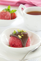 Strawberry sorbet with chocolate and pistachios.