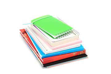 Stack of notebooks isolated on white background.