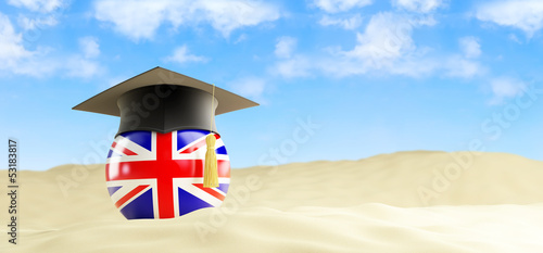 English language on holiday, graduation cap at the beach