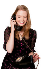 Attractive blonde woman on vintage telephone
