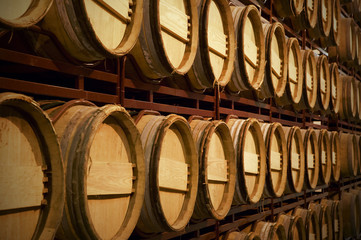 Wine barrels in an aging process