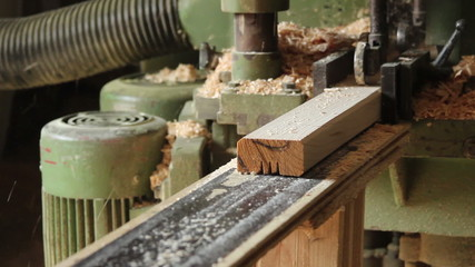 Wooden bar comes from wood grinding machine, dolly shot