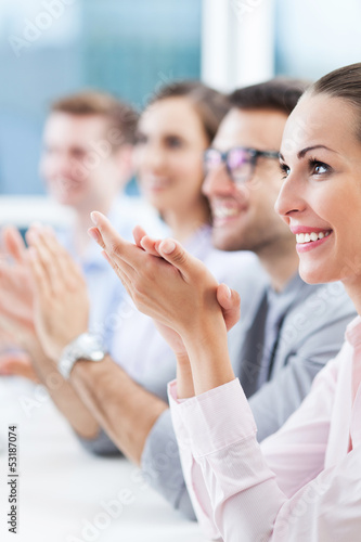 Business team clapping in meeting