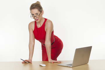 Seductive businesswoman wearing a red dress