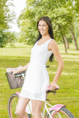 Pretty young woman with bicycle