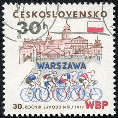 stamp shows a sportsmans on bicycles in Warsaw
