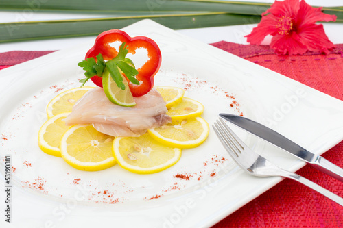 Fish Carpaccio on lemon slices