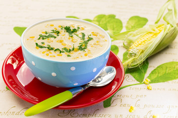 Cream of corn soup in blue bowl