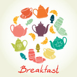 Breakfast set with coffee, croissant, egg, teapot, pancakes