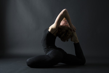 yoga posture ekapada raja kapotasana full pigeon pose side view