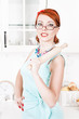 Beautiful housewife with rolling pin