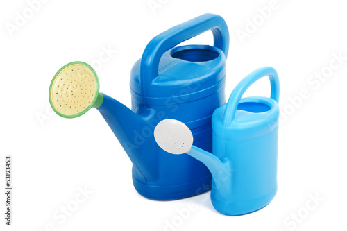 Two plastic watering cans isolated on a white background