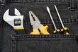 tools in a black jean back pocket