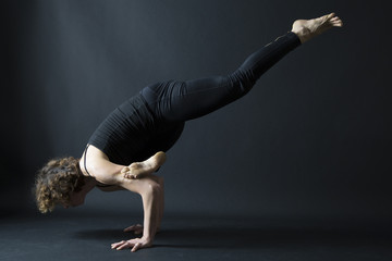 yoga ekapada galavasana flying crow pose side view