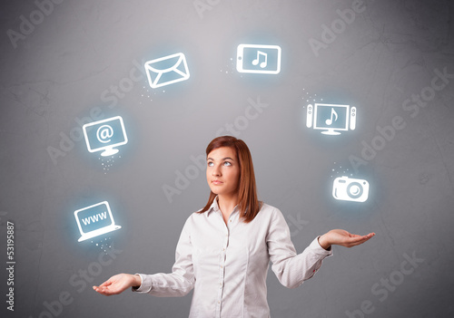 pretty girl juggling with elecrtonic devices icons
