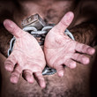 Chained hands asking for freedom