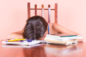 Exhausted student  sleeping with her head on a table