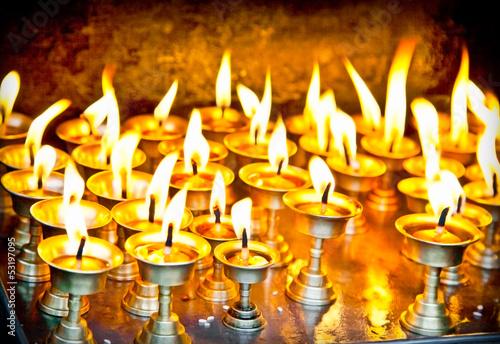 Leinwanddruck Bild Candles at swayambhunath temple in Nepal