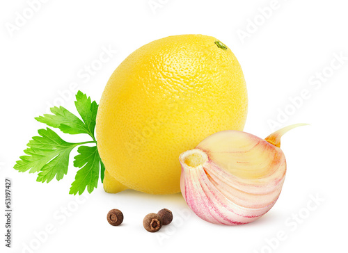 Lemon, garlic and parsley isolated on white