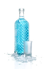 Bottle of vodka with wineglass and ice, isolated on white