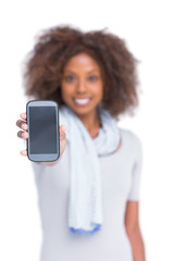 Cheerful woman showing her smartphone