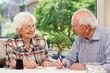 Senior couple playing Yahtzee