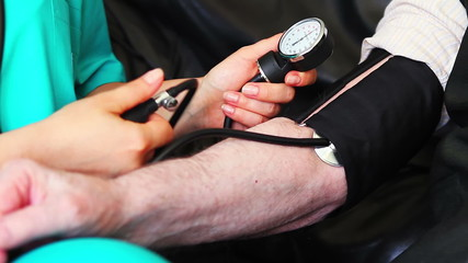 Blood pressure check to a senior
