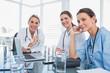 Three smiling women doctors