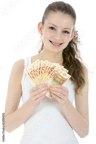 Lachender Teenager mit vielen Geldscheinen