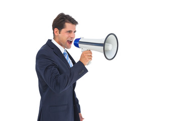 Businessman shouting with a megaphone