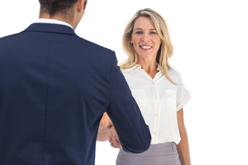Businesswoman shaking hands and looking at the camera