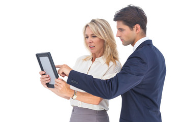 Businessman and woman pointing something on digital tablet