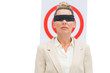 Businesswoman blindfolded and target behind