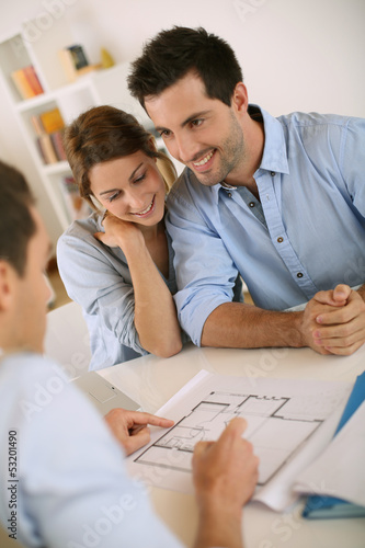 Young couple meeting architect for future house