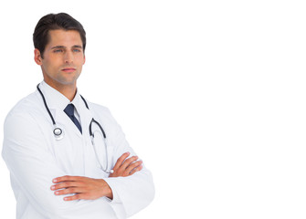 Serious doctor with arms crossed