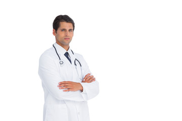 Handsome doctor standing with arms crossed