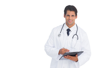 Smiling doctor holding a clipboard and pen