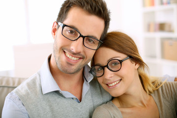 Cute young couple with eyeglasses on