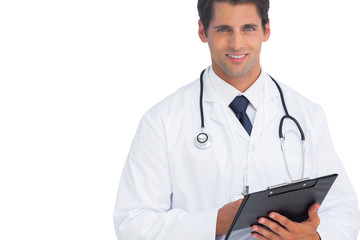 Doctor holding his clipboard and looking at camera