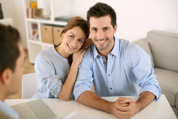 Smiling couple in real-estate agency