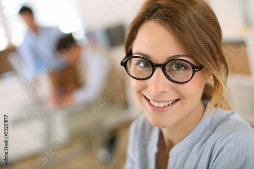 Cheerful student girl wearing eyeglasses