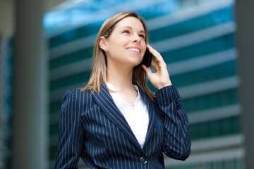 Businesswoman on the phone in urban setting