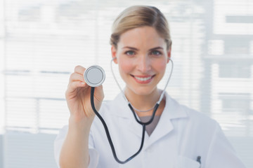 Pretty nurse showing her stethoscope