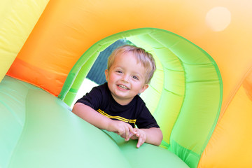 Child on bouncy castle
