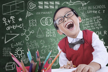 Boy student laughing in class