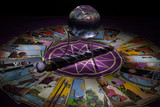Tarot card reading with crystal ball and wand.