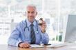 Doctor holding medicine jar